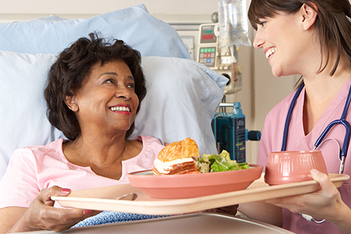 Patient receiving food in hospital from a nurse