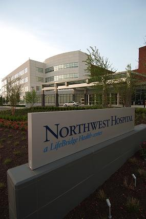 Northwest sign and exterior of building