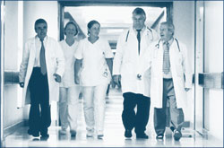 Image of doctors walking down a hallway